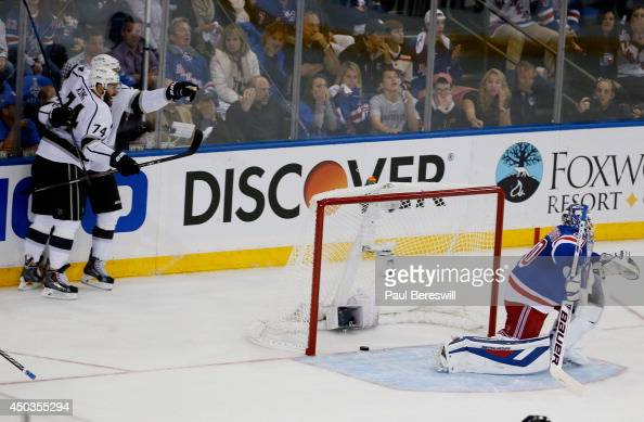 Jeff Carter of the Los Angeles Kings celebrates his first period goal on Henrik Lundqvist of the New York Rangers with Dwight King of the Los Angeles...