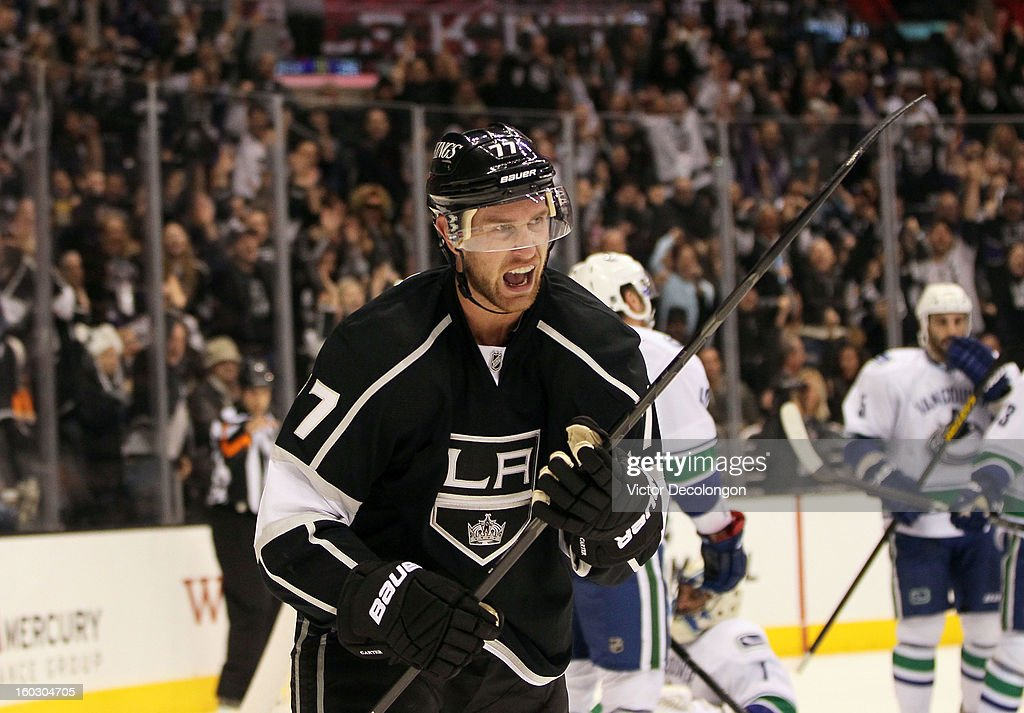 Jeff Carter #77 of the Los Angeles Kings celebrates his goal in the second period during the NHL game against the Vancouver Canucks at Staples Center on January 28, 2013 in Los Angeles, California.