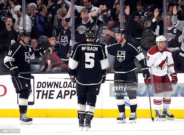 Jeff Carter of the Los Angeles Kings celebrates his goal with Anze Kopitar and Jamie McBain to take a 10 lead in front of Martin Erat of the Arizona...