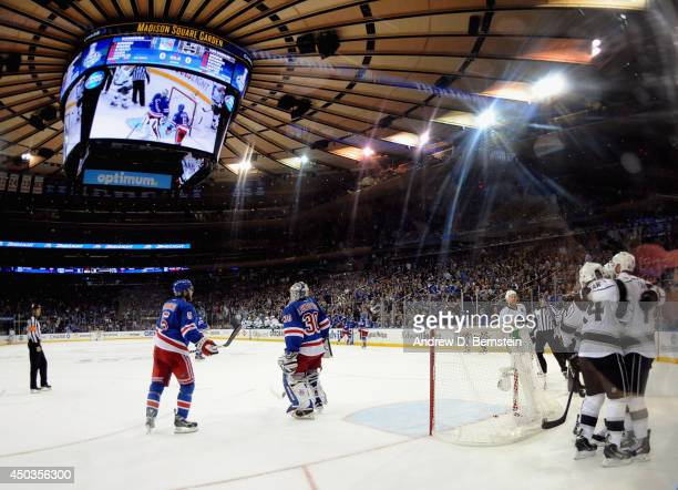 Jeff Carter of the Los Angeles Kings celebrates his goal with Dwight King as goaltender Henrik Lundqvist of the New York Rangers reacts during the...