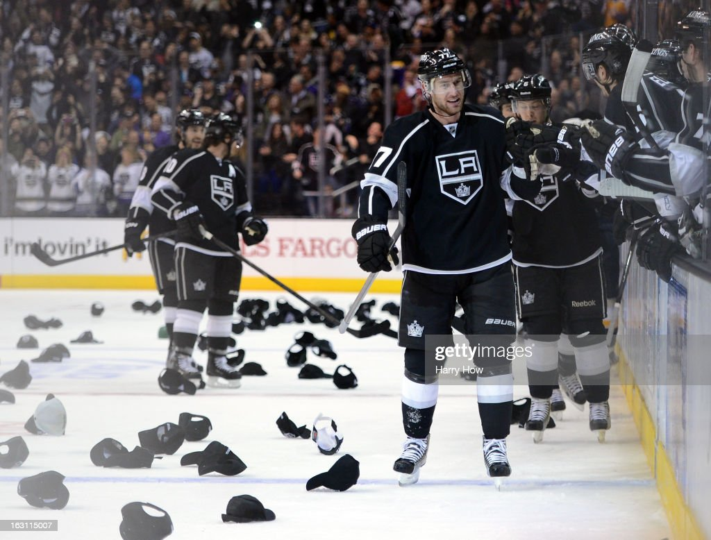Jeff Carter #77 of the Los Angeles Kings celebrates his natural hat trick with his bench for a 3-0 lead over the Nashville Predators during the third period at Staples Center on March 4, 2013 in Los Angeles, California.