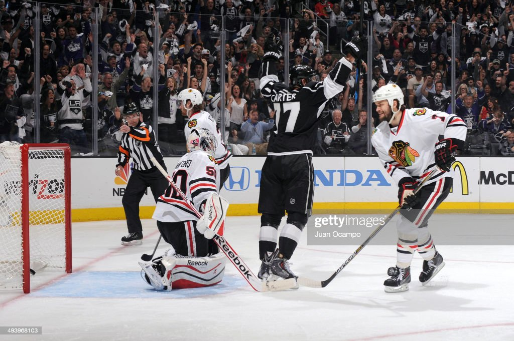 <a gi-track='captionPersonalityLinkClicked' href=/galleries/search?phrase=Jeff+Carter&family=editorial&specificpeople=227320 ng-click='$event.stopPropagation()'>Jeff Carter</a> #77 of the Los Angeles Kings celebrates while <a gi-track='captionPersonalityLinkClicked' href=/galleries/search?phrase=Corey+Crawford&family=editorial&specificpeople=818935 ng-click='$event.stopPropagation()'>Corey Crawford</a> #50 of the Chicago Blackhawks looks on after giving up a goal in Game Four of the Western Conference Final during the 2014 Stanley Cup Playoffs at Staples Center on May 26, 2014 in Los Angeles, California.
