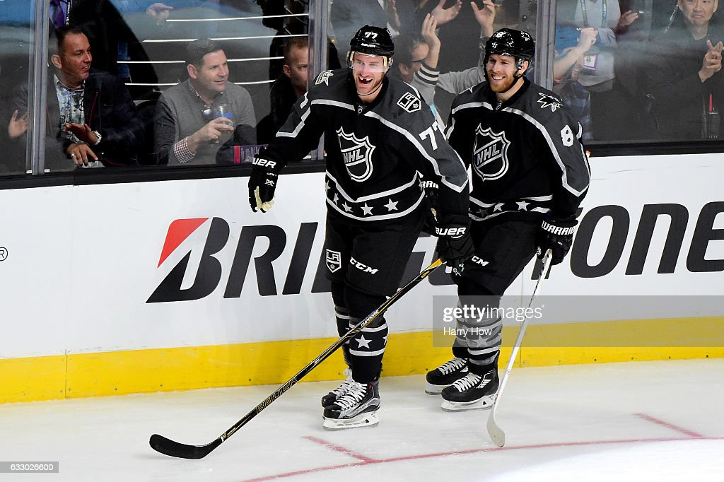 Jeff Carter #77 of the Los Angeles Kings celebrates with Joe Pavelski #8 of the San Jose Sharks during the 2017 Honda NHL All-Star Game Semifinal #1 (Central vs. Pacific) at Staples Center on January 29, 2017 in Los Angeles, California.
