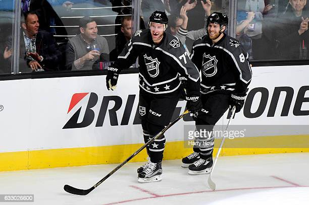 Jeff Carter of the Los Angeles Kings celebrates with Joe Pavelski of the San Jose Sharks during the 2017 Honda NHL AllStar Game Semifinal at Staples...