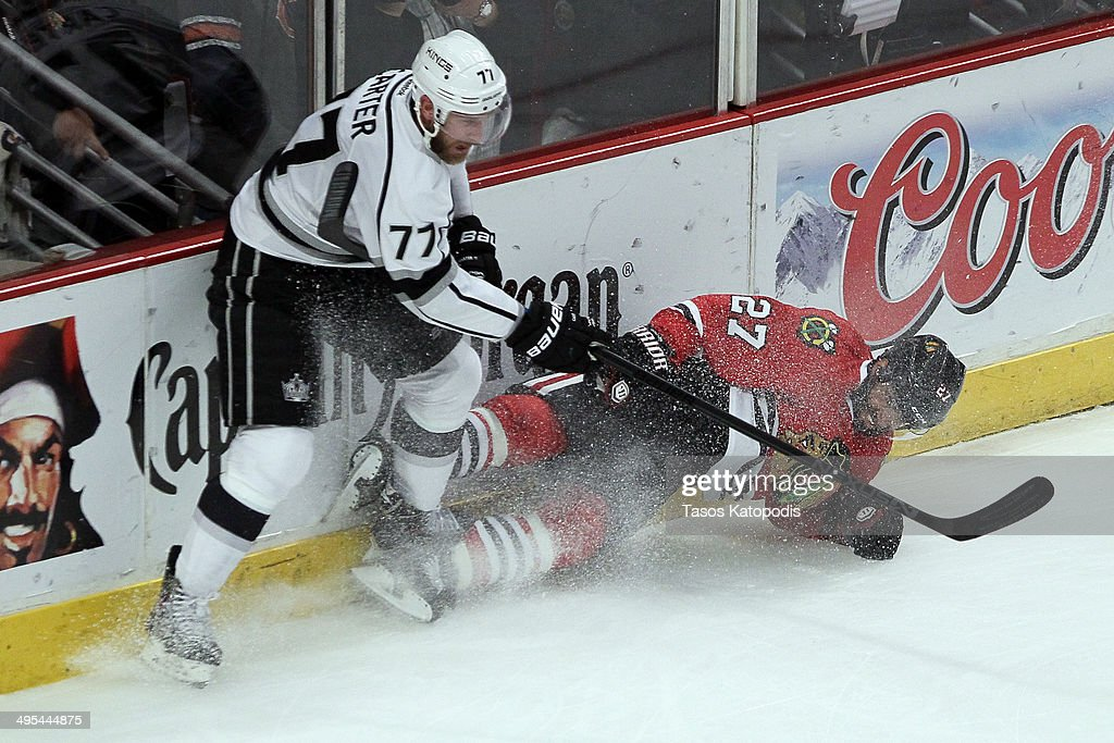 Jeff Carter #77 of the Los Angeles Kings checks Johnny Oduya #27 of the Chicago Blackhawks during Game Seven of the Western Conference Final in the 2014 Stanley Cup Playoffs at United Center on June 1, 2014 in Chicago, Illinois.