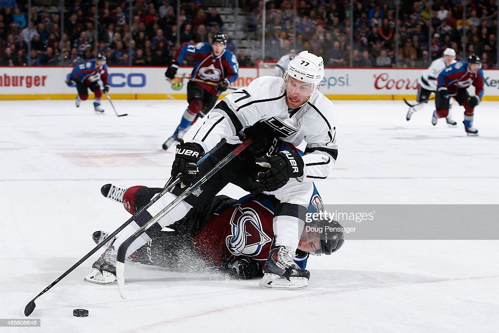 <a gi-track='captionPersonalityLinkClicked' href=/galleries/search?phrase=Jeff+Carter&family=editorial&specificpeople=227320 ng-click='$event.stopPropagation()'>Jeff Carter</a> #77 of the Los Angeles Kings controls the puck as <a gi-track='captionPersonalityLinkClicked' href=/galleries/search?phrase=Matt+Duchene&family=editorial&specificpeople=4819304 ng-click='$event.stopPropagation()'>Matt Duchene</a> #9 of the Colorado Avalanche is penalized for tripping in the first period at Pepsi Center on March 10, 2015 in Denver, Colorado.
