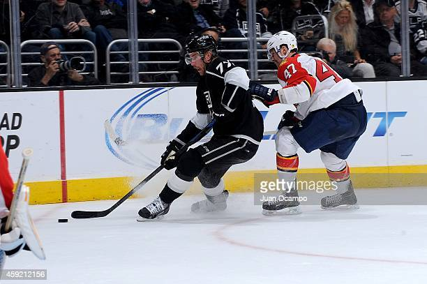 Jeff Carter of the Los Angeles Kings handles the puck against Colby Robak of the Florida Panthers at STAPLES Center on November 18 2014 in Los...