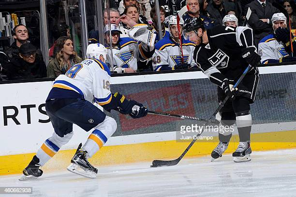 Jeff Carter of the Los Angeles Kings handles the puck against Jay Bouwmeester of the St Louis Blues during a game at STAPLES Center on December 18...