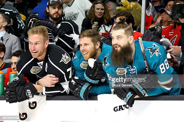 Jeff Carter of the Los Angeles Kings Joe Pavelski of the San Jose Sharks and Brent Burns of the San Jose Sharks look on in the Bridgestone NHL...