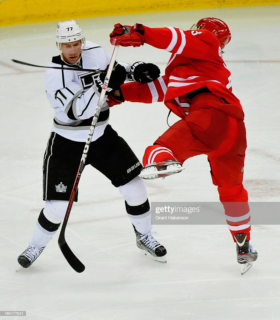 <a gi-track='captionPersonalityLinkClicked' href=/galleries/search?phrase=Jeff+Carter&family=editorial&specificpeople=227320 ng-click='$event.stopPropagation()'>Jeff Carter</a> #77 of the Los Angeles Kings knocks <a gi-track='captionPersonalityLinkClicked' href=/galleries/search?phrase=Brett+Bellemore&family=editorial&specificpeople=4270909 ng-click='$event.stopPropagation()'>Brett Bellemore</a> #73 of the Carolina Hurricanes off his skates during play at PNC Arena on October 11, 2013 in Raleigh, North Carolina.