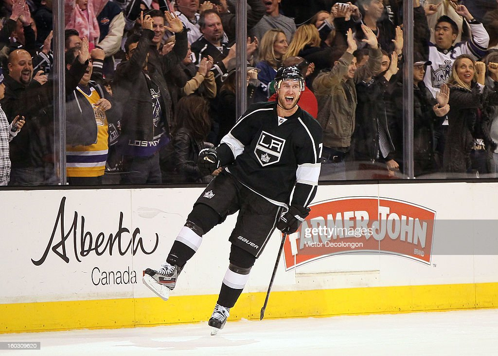 <a gi-track='captionPersonalityLinkClicked' href=/galleries/search?phrase=Jeff+Carter&family=editorial&specificpeople=227320 ng-click='$event.stopPropagation()'>Jeff Carter</a> #77 of the Los Angeles Kings reacts after scoring in shootout overtime during the NHL game against the Vancouver Canucks at Staples Center on January 28, 2013 in Los Angeles, California. The Kings defeated the Canucks 3-2 in shootout overtime.