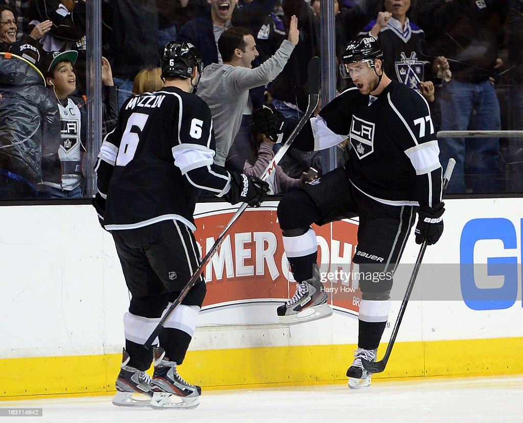 Jeff Carter #77 of the Los Angeles Kings reacts in front of Jake Muzzin #6 after his natural hat trick for a 3-0 lead over the Nashville Predators during the third period at Staples Center on March 4, 2013 in Los Angeles, California.