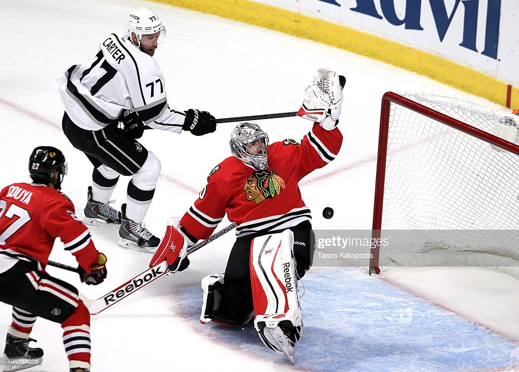<a gi-track='captionPersonalityLinkClicked' href=/galleries/search?phrase=Jeff+Carter&family=editorial&specificpeople=227320 ng-click='$event.stopPropagation()'>Jeff Carter</a> #77 of the Los Angeles Kings scores a goal against <a gi-track='captionPersonalityLinkClicked' href=/galleries/search?phrase=Corey+Crawford&family=editorial&specificpeople=818935 ng-click='$event.stopPropagation()'>Corey Crawford</a> #50 of the Chicago Blackhawks in the first period during Game Seven of the Western Conference Final in the 2014 Stanley Cup Playoffs at United Center on June 1, 2014 in Chicago, Illinois.
