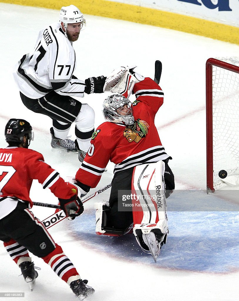 Jeff Carter #77 of the Los Angeles Kings scores a goal against Corey Crawford #50 of the Chicago Blackhawks in the first period during Game Seven of the Western Conference Final in the 2014 Stanley Cup Playoffs at United Center on June 1, 2014 in Chicago, Illinois.