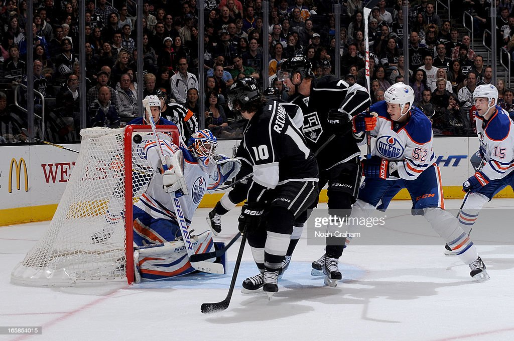 <a gi-track='captionPersonalityLinkClicked' href=/galleries/search?phrase=Jeff+Carter&family=editorial&specificpeople=227320 ng-click='$event.stopPropagation()'>Jeff Carter</a> #77 of the Los Angeles Kings scores a goal against <a gi-track='captionPersonalityLinkClicked' href=/galleries/search?phrase=Devan+Dubnyk&family=editorial&specificpeople=2089794 ng-click='$event.stopPropagation()'>Devan Dubnyk</a> #40 of the Edmonton Oilers at Staples Center on April 6, 2013 in Los Angeles, California.