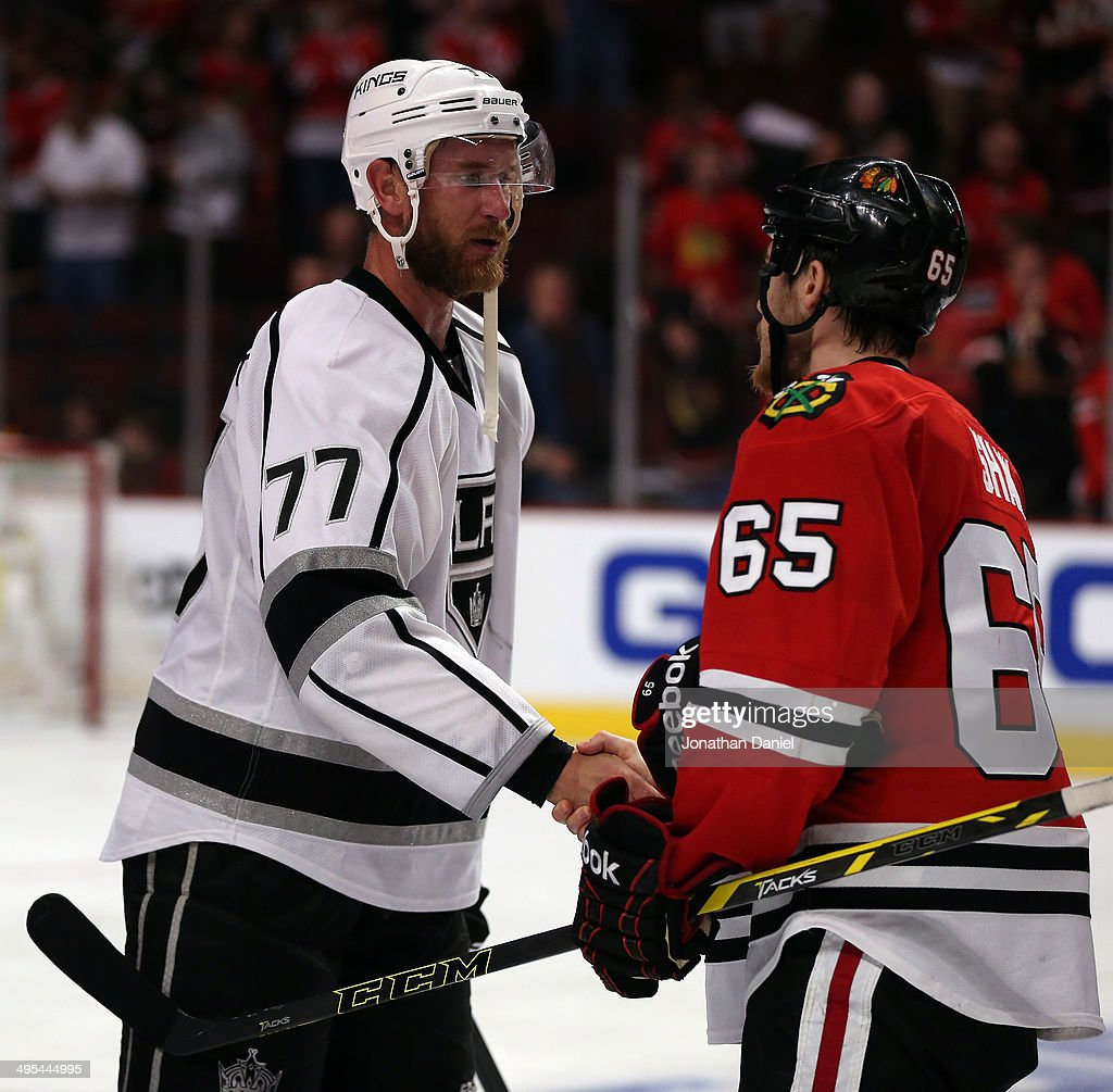 Jeff Carter #77 of the Los Angeles Kings shakes hands with Andrew Shaw #65 of the Chicago Blackhawks during Game Seven of the Western Conference Final in the 2014 Stanley Cup Playoffs at United Center on June 1, 2014 in Chicago, Illinois.