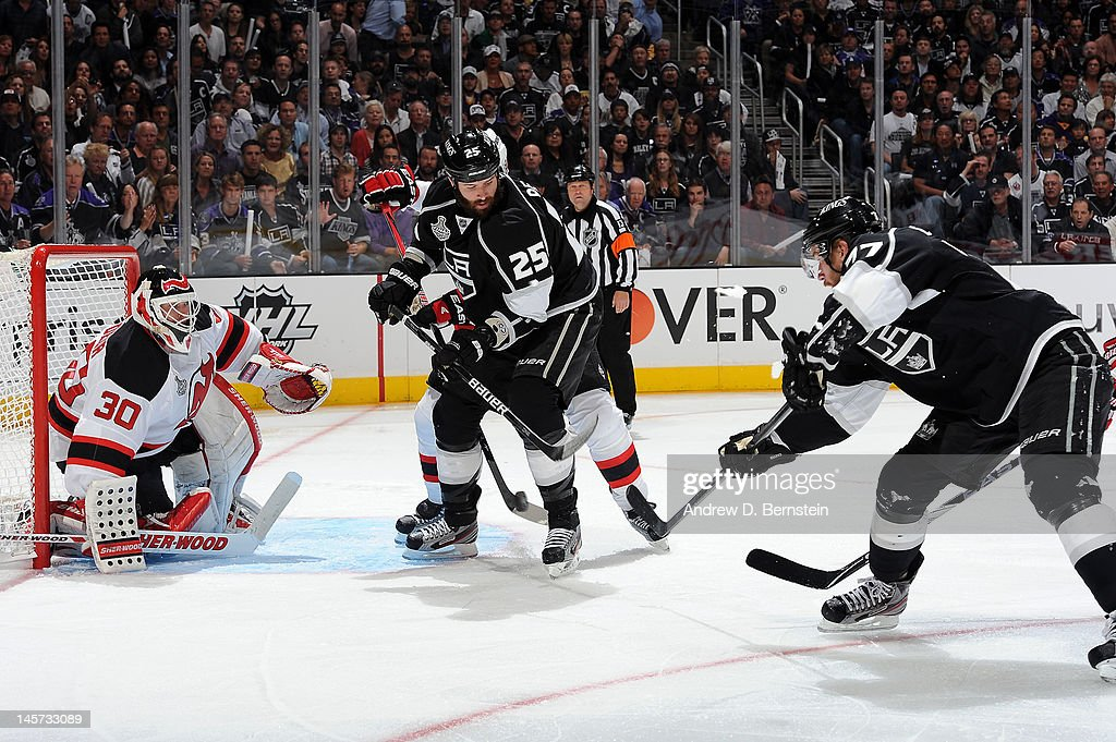 <a gi-track='captionPersonalityLinkClicked' href=/galleries/search?phrase=Jeff+Carter&family=editorial&specificpeople=227320 ng-click='$event.stopPropagation()'>Jeff Carter</a> #77 of the Los Angeles Kings shoots and scores a goal against <a gi-track='captionPersonalityLinkClicked' href=/galleries/search?phrase=Martin+Brodeur&family=editorial&specificpeople=201594 ng-click='$event.stopPropagation()'>Martin Brodeur</a> #30 of the New Jersey Devils in Game Three of the 2012 Stanley Cup Final at Staples Center on June 4, 2012 in Los Angeles, California.