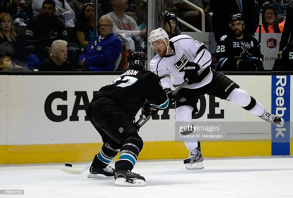 Jeff Carter #77 of the Los Angeles Kings shoots his shot past Scott Hannan #27 of the San Jose Sharks in the third period in Game Three of the Western Conference Semifinals during the 2013 NHL Stanley Cup Playoffs at HP Pavilion on May 18, 2013 in San Jose, California. The Sharks defeated the Kings in overtime 2-1.