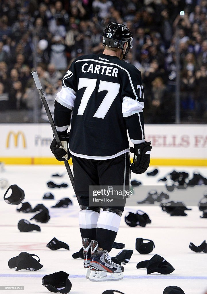 Jeff Carter #77 of the Los Angeles Kings skates as hats fill the ice in recognition of his natural hat trick for a 3-0 lead over the Nashville Predators during the third period at Staples Center on March 4, 2013 in Los Angeles, California.