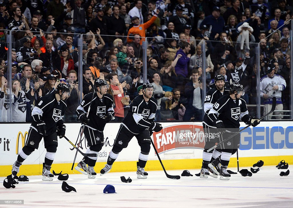 Jeff Carter #77 of the Los Angeles Kings skates back to the bench after his natural hat trick for a 3-0 lead over the Nashville Predators during the third period at Staples Center on March 4, 2013 in Los Angeles, California.