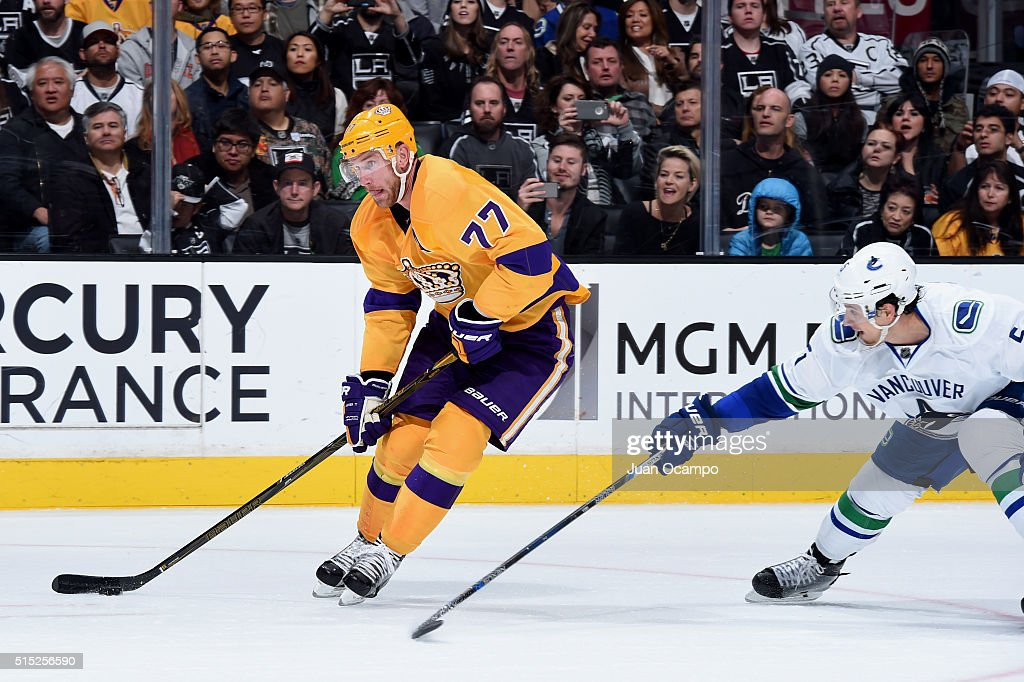 Jeff Carter of the Los Angeles Kings skates with the puck against Luca Sbisa of the Vancouver Canucks on March 7 2016 at Staples Center in Los...
