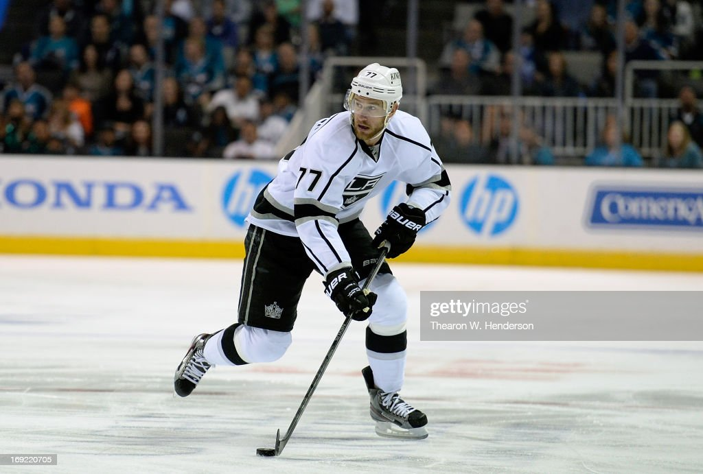 Jeff Carter #77 of the Los Angeles Kings skates with the puck against the San Jose Sharks in the first period in Game Four of the Western Conference Semifinals during the 2013 NHL Stanley Cup Playoffs at HP Pavilion on May 21, 2013 in San Jose, California. The Sharks defeated the Kings 2-1.