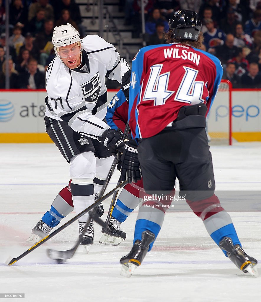 Jeff Carter #77 of the Los Angeles Kings takes a shot against Ryan Wilson #44 of the Colorado Avalanche at the Pepsi Center on January 22, 2013 in Denver, Colorado. The Avalanche defeated the Kings 3-1.