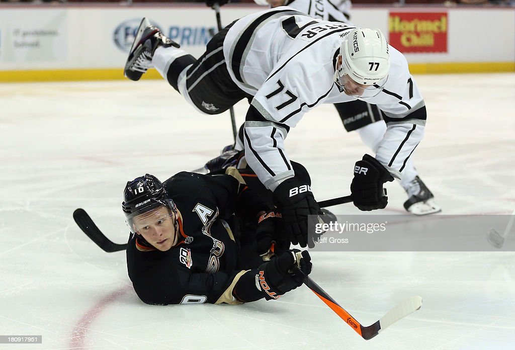 <a gi-track='captionPersonalityLinkClicked' href=/galleries/search?phrase=Jeff+Carter&family=editorial&specificpeople=227320 ng-click='$event.stopPropagation()'>Jeff Carter</a> #77 of the Los Angeles Kings trips over <a gi-track='captionPersonalityLinkClicked' href=/galleries/search?phrase=Corey+Perry&family=editorial&specificpeople=213864 ng-click='$event.stopPropagation()'>Corey Perry</a> #10 of the Anaheim Ducks in the first period at Honda Center on September 17, 2013 in Anaheim, California.