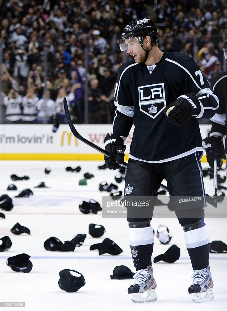 Jeff Carter #77 of the Los Angeles Kings watches as hats fill the ice in recognition of his natural hat trick for a 3-0 lead over the Nashville Predators during the third period at Staples Center on March 4, 2013 in Los Angeles, California.