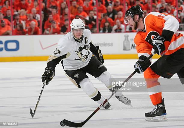 Jeff Carter of the Philadelphia Flyers skates with the puck against Sidney Crosby of the Pittsburgh Penguins during Game Six of the Eastern...