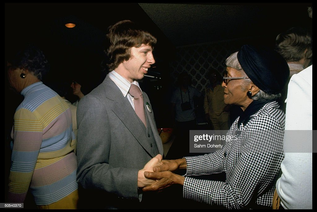 Jeff Carter, son of presidential hopeful Jimmy Carter, shaking hands with unidentified female supporter while campaigning for his father.