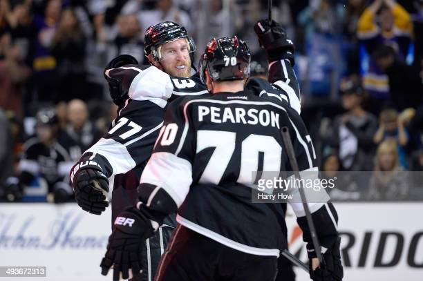 Jeff Carter Tanner Pearson and Tyler Toffoli of the Los Angeles Kings celebrate after Carter scores a second period goal against the Chicago...