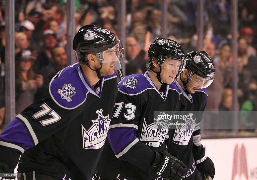 <a gi-track='captionPersonalityLinkClicked' href=/galleries/search?phrase=Jeff+Carter&family=editorial&specificpeople=227320 ng-click='$event.stopPropagation()'>Jeff Carter</a> #77, Tyler Toffoli #73 and <a gi-track='captionPersonalityLinkClicked' href=/galleries/search?phrase=Slava+Voynov&family=editorial&specificpeople=8315719 ng-click='$event.stopPropagation()'>Slava Voynov</a> #26 of the Los Angeles Kings skate back toward the bench after celebrating Toffoli's goal in the second period during the NHL game against the Phoenix Coyotes at Staples Center on March 18, 2013 in Los Angeles, California. The Kings defeated the Coyotes 4-0.