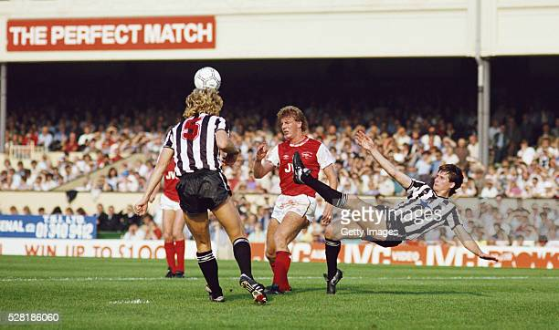 Jeff Clarke and Glenn Roeder combine to thwart Tommy Caton of Arsenal during a First Division match at Highbury on September 28 1985 in London England