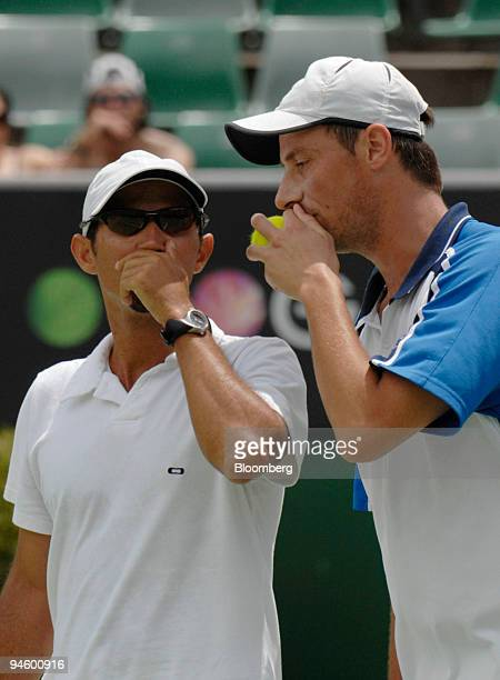 Jeff Coetzee of South Africa left and Rogier Wassan of the Netherlands consult each other during their doubles match against brothers Mike and Bob...