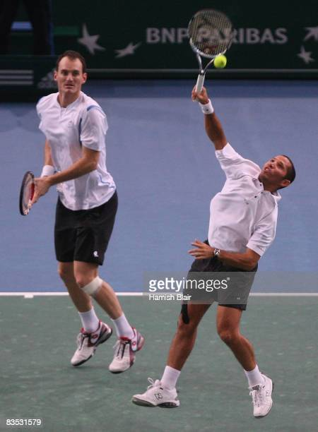 Jeff Coetzee of South Africa plays a return with team mate Wesley Moodie of South Africa during their doubles final against Jonas Bjorkman of Sweden...