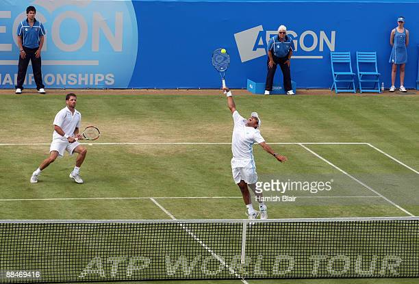 Jeff Coetzee of South Africa plays a smash playing with Jordan Kerr of Australia during the men's doubles semi final match against Marcelo Melo of...
