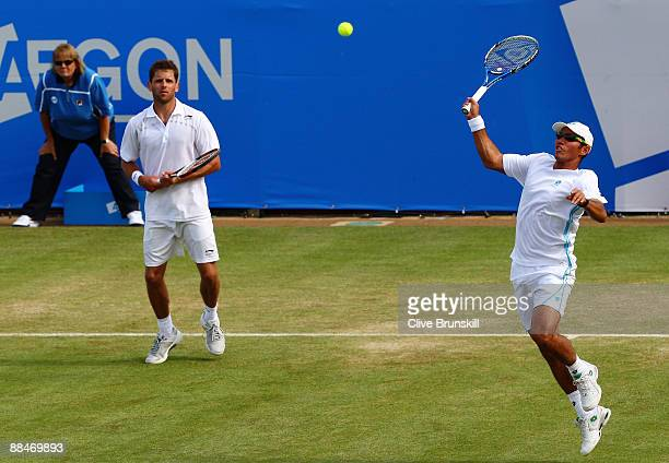 Jeff Coetzee of South Africa plays a smash playing with Jordan Kerr of Australia during the men's doubles semi final match against Andre Sa of Brazil...