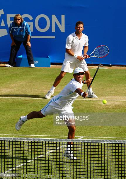 Jeff Coetzee of South Africa plays a volley playing with Jordan Kerr of Australia during the men's doubles semi final match against Andre Sa of...
