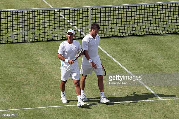 Jeff Coetzee of South Africa talks with Jordan Kerr of Australia during the men's doubles semi final match against Marcelo Melo of Brazil and Andre...