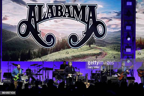 Jeff Cook Randy Owen and Teddy Gentry of Alabama perform in concert during the 'Deep From The Heart One America Appeal Concert' at Reed Arena on...