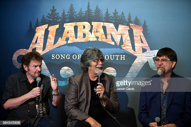 Jeff Cook Randy Owen and Teddy Gentry of the band Alabama speak during the debut of the 'Alabama Song of the South' exhibition at Country Music Hall...