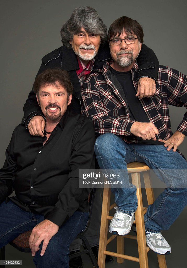 Jeff Cook, Randy Owen, and Teddy Gentry pose backstage at One More For The Fans! - Celebrating the Songs & Music of Lynyrd Skynyrd at The Fox Theatre on November 12, 2014 in Atlanta, Georgia.