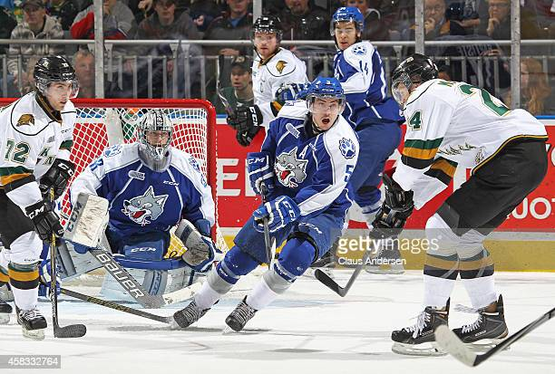 Jeff Corbett of the Sudbury Wolves defends in front of teammate Troy Timpano during play against the London Knights in an OHL game at the Budweiser...