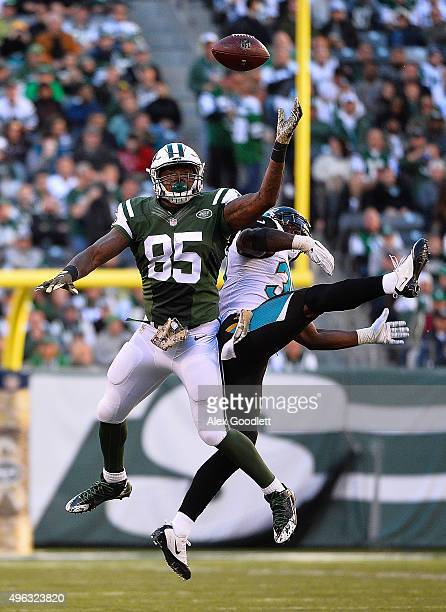 Jeff Cumberland of the New York Jets attempts to catch a pass under pressure from Johnathan Cyprien of the Jacksonville Jaguars during the third...