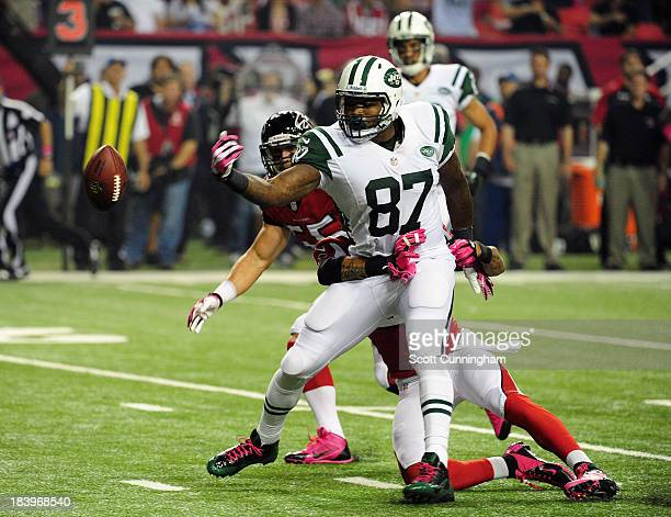 Jeff Cumberland of the New York Jets has a pass broken up by Thomas DeCoud of the Atlanta Falcons at the Georgia Dome on October 7 2013 in Atlanta...