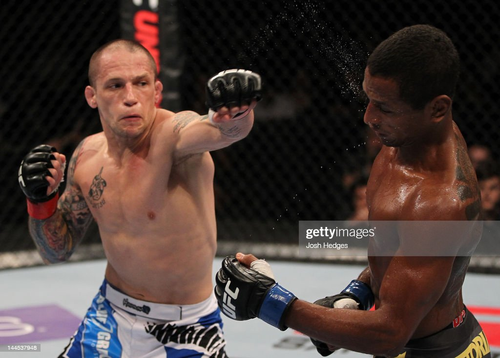 Jeff Curran punches Johnny Eduardo in a bantamweight bout during the UFC on Fuel TV event at Patriot Center on May 15, 2012 in Fairfax, Virginia.