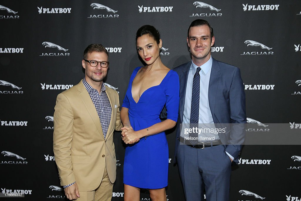 Jeff Curry, Brand Vice President, Jaguar North America, actress <a gi-track='captionPersonalityLinkClicked' href=/galleries/search?phrase=Gal+Gadot&family=editorial&specificpeople=4350069 ng-click='$event.stopPropagation()'>Gal Gadot</a> and Cooper Hefner attend the Jaguar and Playboy Magazine exclusive VIP reception to celebrate Jaguar's high-performance models during Pebble Beach weekend on August 16, 2013 in Monterey, California.