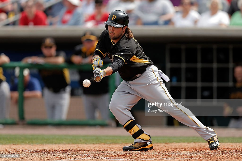 Jeff Decker #14 of the Pittsburgh Pirates bunts a ball in the sixth inning of a game against the Philadelphia Phillies at Bright House Field on March 16, 2014 in Clearwater, Florida. Pittsburgh won the game 5-0.