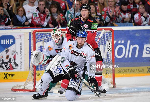 Jeff Deslauriers Arvids Rekis of the Augsburger Panther and Ryan Jones of the Koelner Haie during the DEL game between Koelner Haie and the...